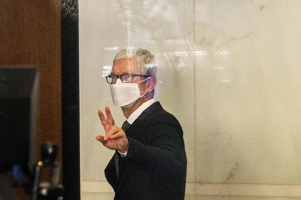 Apple CEO Tim Cook leaves the Ronald V. Dellums building in Oakland, Calif., after testifying in a federal court case brought by Epic Games on Friday, May 21, 2021. Epic, maker of the video game Fortnite, charges that Apple has transformed its App Store into an illegal monopoly. (AP Photo/Noah Berger)