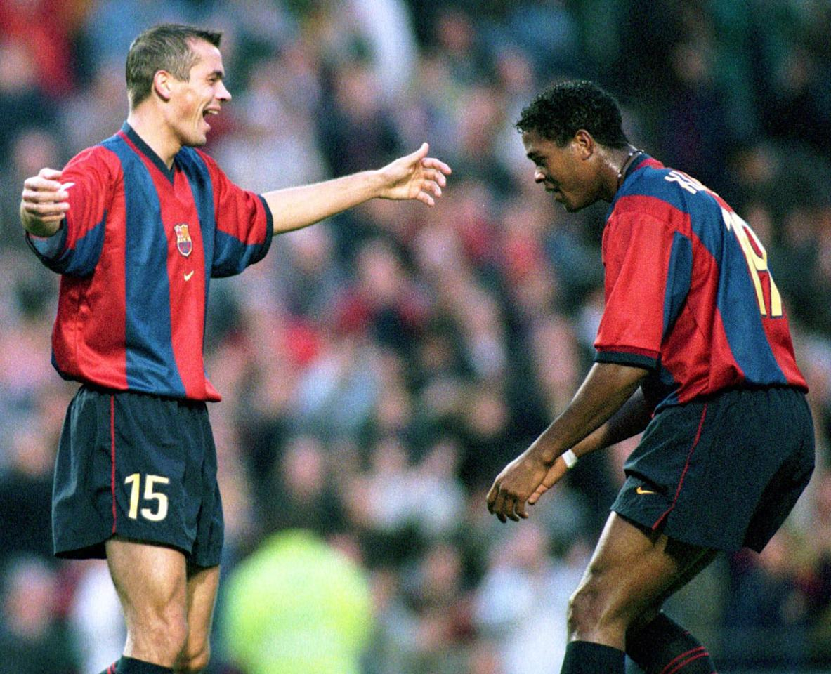 F.C. Barcelona's Dutch players Philip John William Cocu, left, celebrates with  Patrick Kluivert after Cocu scored a goal during a league soccer match against Tenerife in Barcelona Sunday November 15, 1998. (AP Photo/Cesar Rangel)