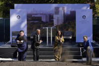 Former President Barack Obama, second from left, is joined by Illinois Gov. J.B. Pritzker, left, former first lady Michelle Obama, and Chicago Mayor Lori Lightfoot during a groundbreaking ceremony for the Obama Presidential Center Tuesday, Sept. 28, 2021, in Chicago. (AP Photo/Charles Rex Arbogast)