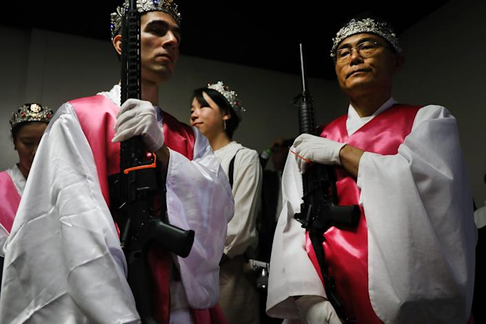 Members of the World Peace and Unification Sanctuary hold their AR-15 rifles as they participate in a Life Holy Marriage Blessing at the church on October 14, 2019 in Newfoundland, Pennsylvania.