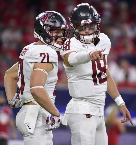 Washington State quarterback Anthony Gordon, right, gives instructions to running back Max Borghi during the first half of the team's NCAA college football game against Houston, Friday, Sept. 13, 2019, in Houston. (AP Photo/Eric Christian Smith)