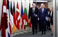 Ireland's Foreign and Trade Minister Simon Coveney and European Union's chief Brexit negotiator Michel Barnier arrive for a meeting in Brussels, Belgium, March 19, 2018. Olivier Hoslet/Pool via Reuters