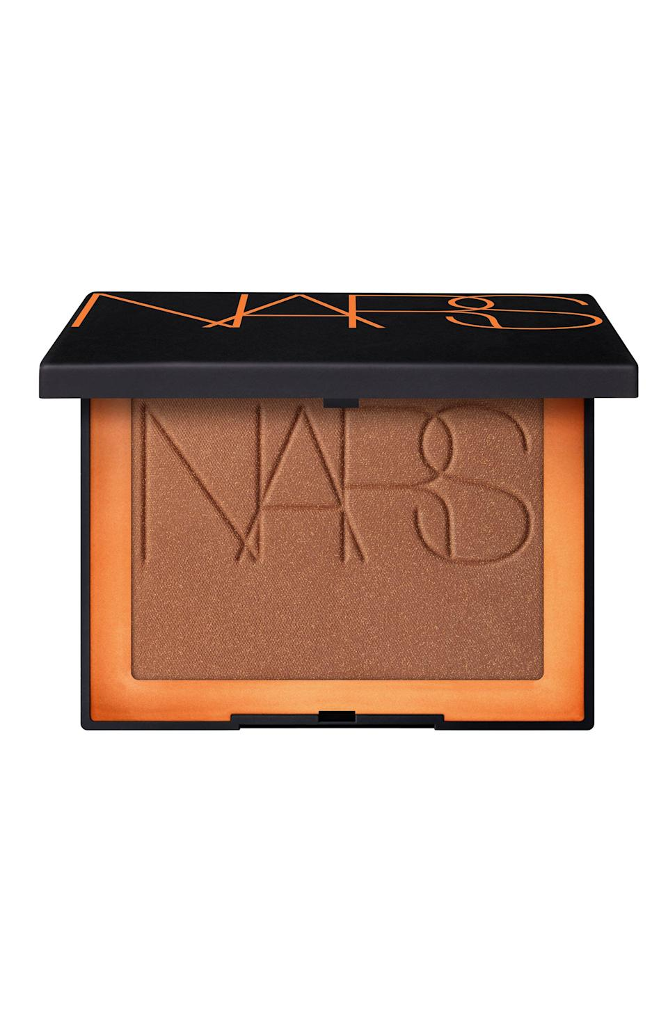 """<p><strong>NARS</strong></p><p>nordstrom.com</p><p><strong>$38.00</strong></p><p><a href=""""https://go.redirectingat.com?id=74968X1596630&url=https%3A%2F%2Fwww.nordstrom.com%2Fs%2Fnars-bronzing-powder%2F5577018&sref=https%3A%2F%2Fwww.goodhousekeeping.com%2Fbeauty-products%2Fg36020083%2Fbest-bronzer-for-dark-skin%2F"""" rel=""""nofollow noopener"""" target=""""_blank"""" data-ylk=""""slk:Shop Now"""" class=""""link rapid-noclick-resp"""">Shop Now</a></p><p>This finely-milled powder from Nars is a favorite among celebrity makeup artists and beauty editors alike. It provides a smooth application, and the <strong>slight golden shimmer</strong> gives your face definition and a warm glow. This shade is great for both olive and dark skin tones. </p>"""