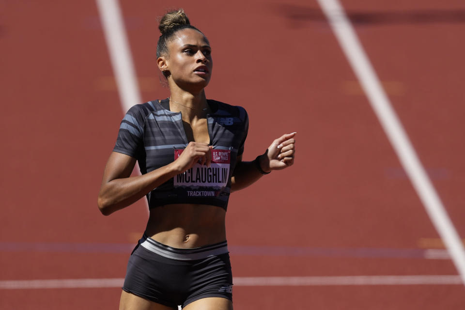 Sydney McLaughlin wins a semi-final in the women's 400-meter hurdles at the U.S. Olympic Track and Field Trials Friday, June 25, 2021, in Eugene, Ore. (AP Photo/Ashley Landis)
