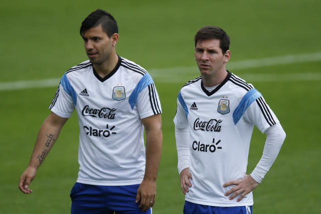 Argentina's Lionel Messi, right, walks next to teammate Sergio Aguero during a training session in Vespasiano, near Belo Horizonte, Brazil, Thursday, June 12, 2014. Argentina will play in group F of the Brazil 2014 soccer World Cup. (AP Photo/Victor R. Caivano)