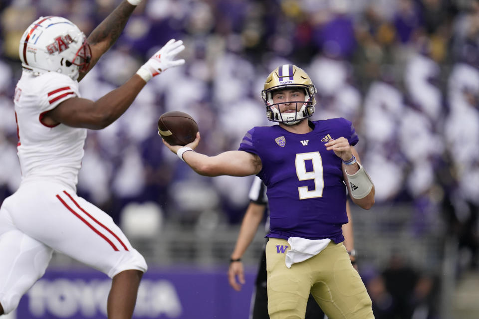 Washington quarterback Dylan Morris (9) throws against Arkansas State in the first half of an NCAA college football game, Saturday, Sept. 18, 2021, in Seattle. (AP Photo/Elaine Thompson)