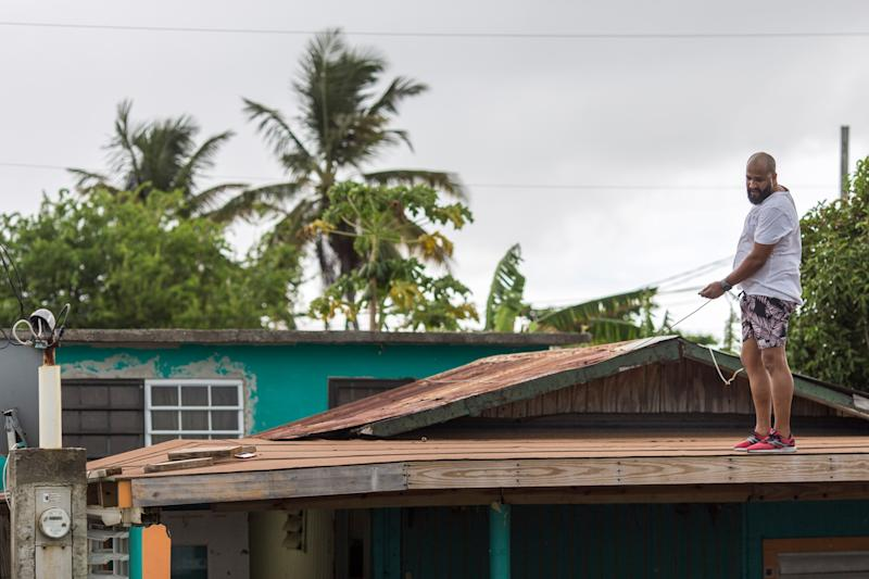 Lemuel Otero, 40, battening down the roof at his property in Maternillo, Fajardo, as Puerto Rico prepares to be hit by Tropical Storm Dorian on Wednesday, Aug. 28. (Photo: Dennis M. Rivera Pichardo for HuffPost)