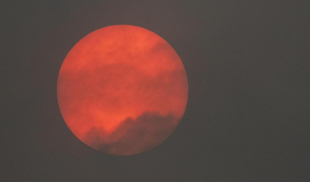 London sky cloaked in strange orange glow in Storm Ophelia dust phenomenon