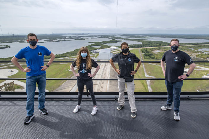 FILE - In this Monday, March 29, 2021 photo provided by SpaceX, from left, Jared Isaacman, Hayley Arceneaux, Sian Proctor and Chris Sembroski pose for a photo on the SpaceX launch tower at NASA's Kennedy Space Center at Cape Canaveral, Fla. SpaceX's high tech capsules are completely automated, as are Blue Origin's. So should wealthy riders and their guests be called astronauts even if they learn the ropes in case they need to intervene in an emergency? (SpaceX via AP, File)