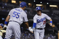 Los Angeles Dodgers' Andy Burns (29), who scored on a balk, is congratulated by Albert Pujols (55) during the eighth inning of the team's baseball game against the Arizona Diamondbacks on Friday, June 18, 2021, in Phoenix. The Dodgers won 3-0. (AP Photo/Ross D. Franklin)