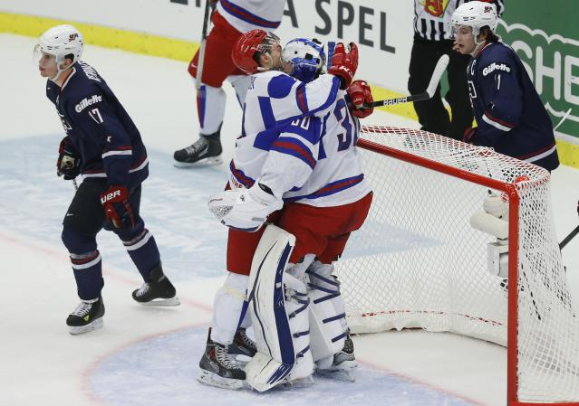 Russia's Slepyshev and Vasilevski react past U.S. team players Barber and Kerdiles in their IIHF Ice Hockey World Championship quarter-final match in Malmo