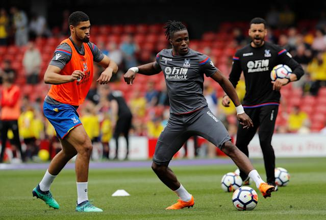 """Soccer Football - Premier League - Watford v Crystal Palace - Vicarage Road, Watford, Britain - April 21, 2018 Crystal Palace's Wilfried Zaha and Ruben Loftus-Cheek during the warm up before the match REUTERS/Darren Staples EDITORIAL USE ONLY. No use with unauthorized audio, video, data, fixture lists, club/league logos or """"live"""" services. Online in-match use limited to 75 images, no video emulation. No use in betting, games or single club/league/player publications. Please contact your account representative for further details."""