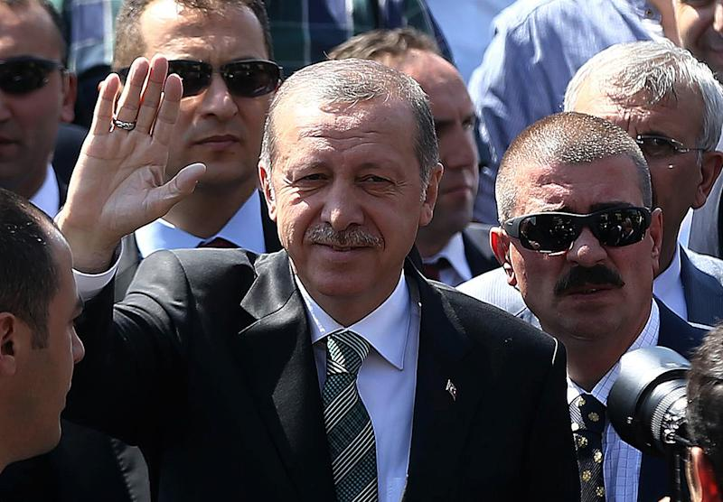 Turkey's president-elect Recep Tayyip Erdogan (C) waves at people after Friday prayers in Ankara, on August 15, 2014