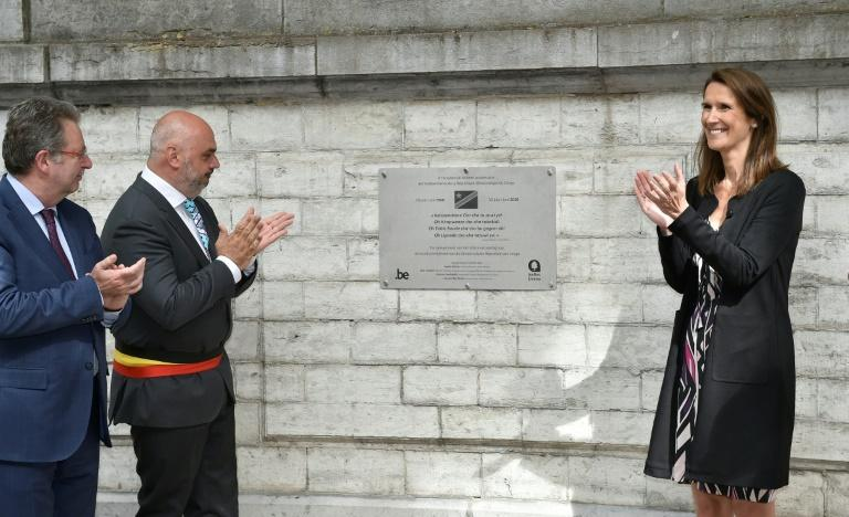 Belgian Prime Minister Sophie Wilmes and Ixelles-Elsene mayor Christos Doulkeridis unveil a plaque on the 60th anniversary of DR Congo's independence