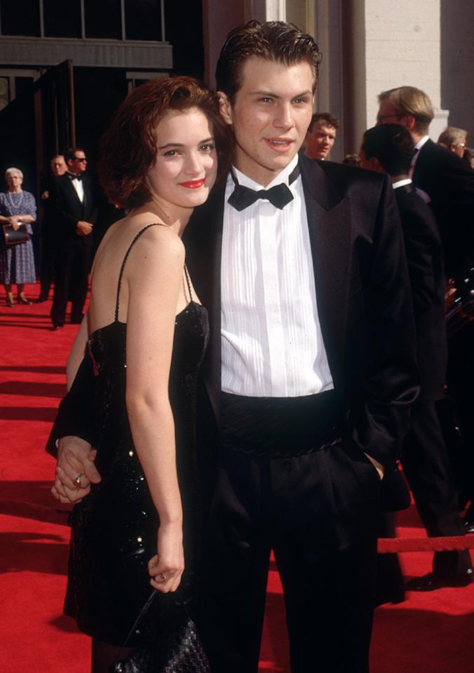 <p>Ryder and Christian Slater briefly dated after meeting during the filming of their cult teen classic <i>Heathers</i> in 1988. The two attended the Oscars on March 29, 1989. (Photo: Darlene Hammond/ Getty Images)</p>