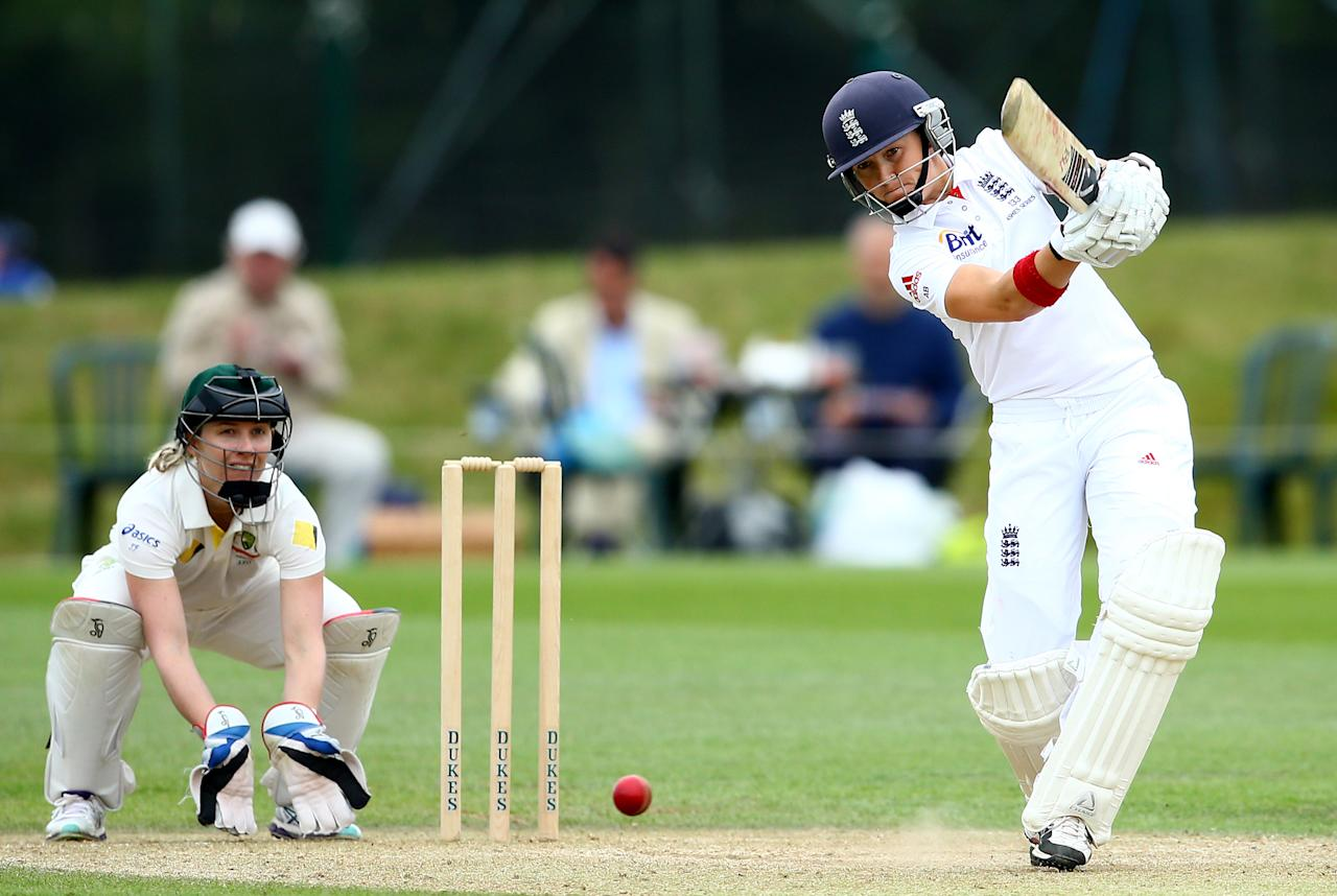 HIGH WYCOMBE, ENGLAND - AUGUST 14:   Arran Brindle of England drives the ball with Jodie Fields of Australia looking on during day four of the Women's Ashes Series match between England and Australia at Wormsley Cricket Ground on August 14, 2013 in High Wycombe, England.  (Photo by Jan Kruger/Getty Images)
