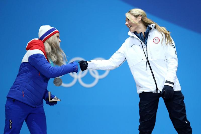 Gold medalist Mikaela Shiffrin and silver medalist Ragnhild Mowinckel, greet each other with a fist bump during the medal ceremony. Photo: Getty