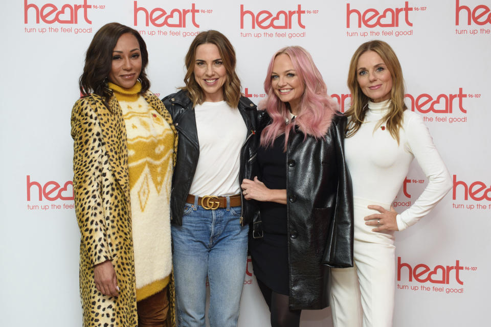 """Spice Girls from left, Melanie Brown, Melanie Chisholm, Emma Bunton and Geri Horner  pose for a photo during a live appearance on a radio show at Global Radio in Leicester Square, London, Wednesday, Nov. 7, 2018. The Spice Girls will reunite for a British stadium tour next summer. The band plan to take the stage without fashion designer Victoria Beckham, who performed as """"Posh Spice"""" during the group's 1990s pop heyday. (Matt Crossick/PA via AP)"""