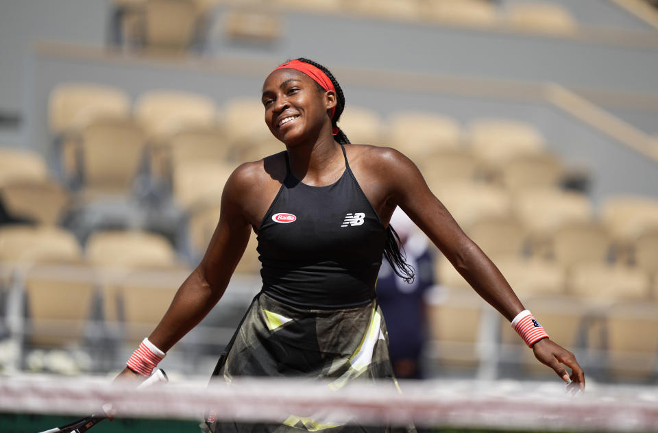 United States's Coco Gauff celebrates after defeating Tunisia's Ons Jabeur during their fourth round match on day 9, of the French Open tennis tournament at Roland Garros in Paris, France, Monday, June 7, 2021. (AP Photo/Michel Euler)