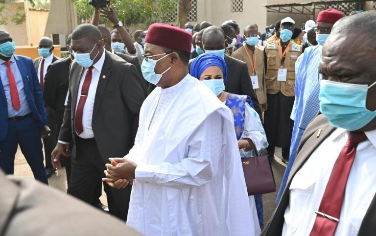 Niger's outgoing president Mahamadou Issoufou, centre, after casting his vote in the December 27 elections