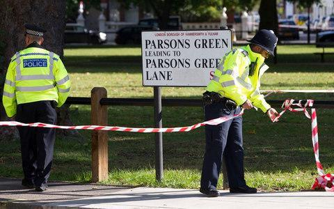 <span>Police cordon off an area of Parsons Green</span> <span>Credit: JEFF GILBERT for The Telegraph </span>