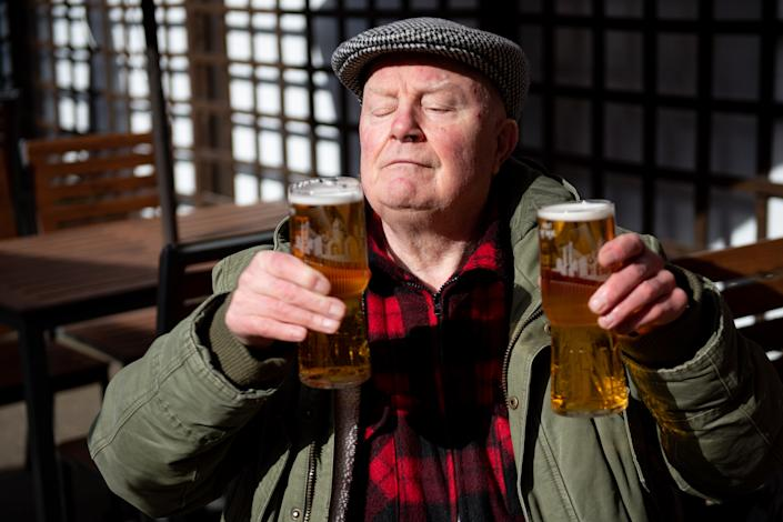 John Witts enjoys a drink at the reopening of the Figure of Eight pub, in Birmingham, as England takes another step back towards normality with the further easing of lockdown restrictions. Picture date: Monday April 12, 2021.