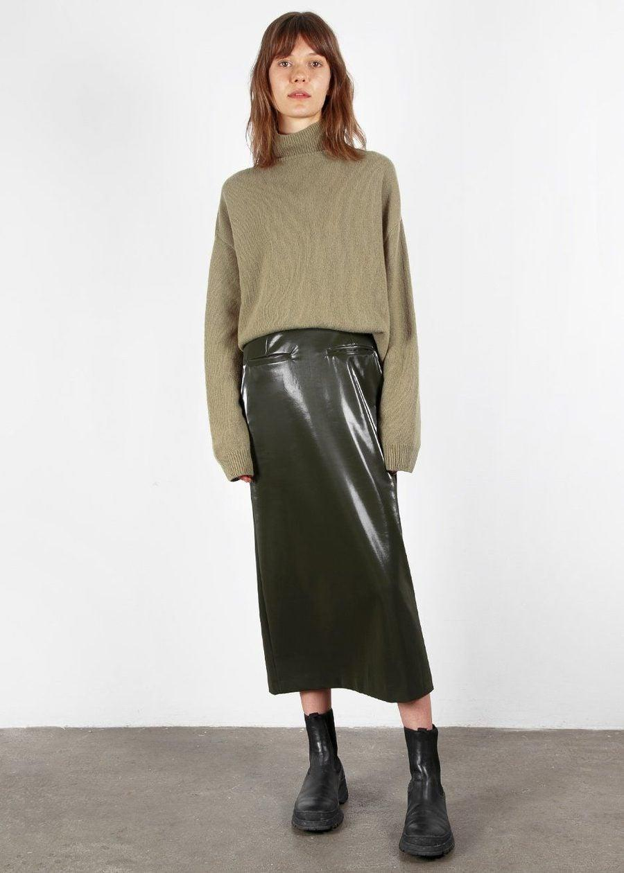 "<br><br><strong>The Frankie Shop</strong> Olive Gloss Midi Skirt, $, available at <a href=""https://go.skimresources.com/?id=30283X879131&url=https%3A%2F%2Fthefrankieshop.com%2Fcollections%2Fon-sale%2Fproducts%2Folive-gloss-midi-skirt"" rel=""nofollow noopener"" target=""_blank"" data-ylk=""slk:The Frankie Shop"" class=""link rapid-noclick-resp"">The Frankie Shop</a>"