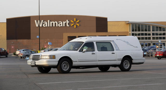 <p>A hearse sits in the parking lot of a Walmart store where eight people were found dead in a tractor-trailer loaded with at least 30 others outside in stifling summer heat in what police are calling a horrific human trafficking case, Sunday, July 23, 2017, in San Antonio. (AP Photo/Eric Gay) </p>
