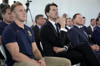 Former Australian rugby Rugby World Cup winning captain John Eales, center, watches a media event in Sydney where Australia formally announced its bid to host the 2027 Rugby World Cup Thursday, May 20, 2021. It would be the third time the sport's showcase event would be held in the country. (AP Photo/Mark Baker)