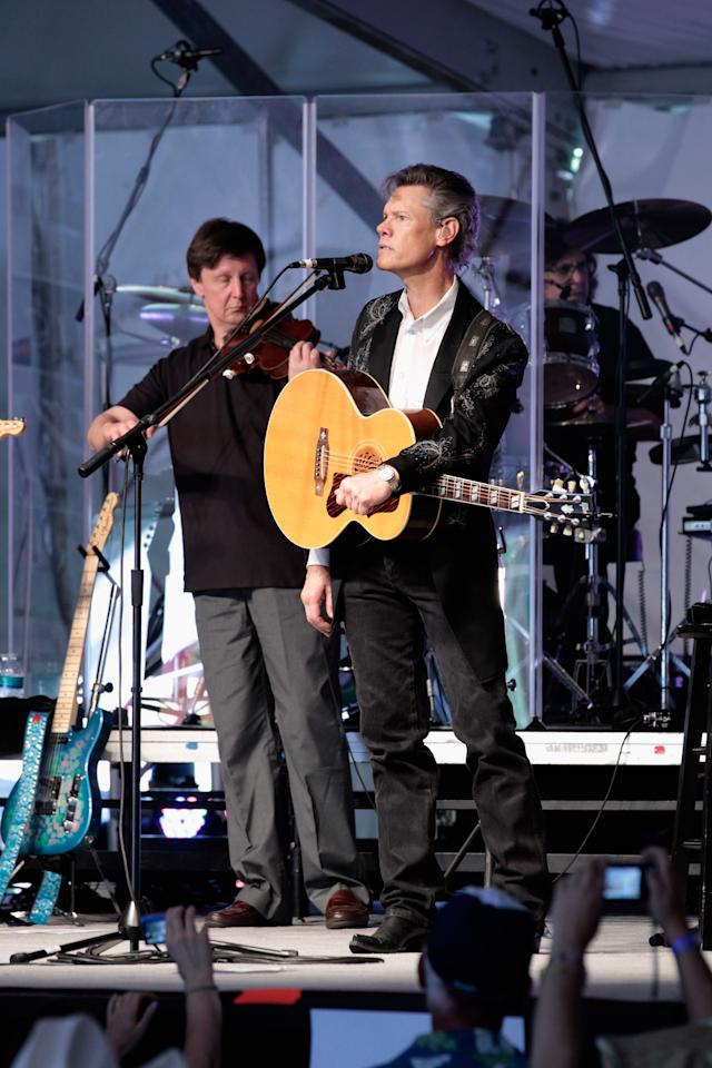 AMES, IA - AUGUST 13:  Country music performer Randy Travis (R) performs in Republican presidential candidate Rep. Michele Bachmann's (R-MN) tent during the Iowa Straw Poll on the grounds of Iowa State University August 13, 2011 in Ames, Iowa. Nine GOP presidential candidates are competing for votes in the Iowa Straw Poll, an important step for gaining momentum in a crowded field of hopefuls.  (Photo by Chip Somodevilla/Getty Images)