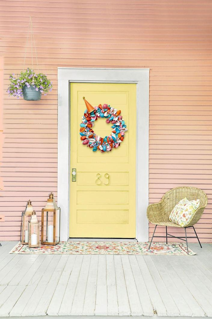 """<p>First, gather your supplies: A <a href=""""https://www.amazon.com/Craft-Foam-Wreath-Polystyrene-Decorations/dp/B07FNK6YMB?tag=syn-yahoo-20&ascsubtag=%5Bartid%7C10070.g.37055923%5Bsrc%7Cyahoo-us"""" rel=""""nofollow noopener"""" target=""""_blank"""" data-ylk=""""slk:foam wreath form"""" class=""""link rapid-noclick-resp"""">foam wreath form</a>, <a href=""""https://www.amazon.com/Balloons-Birthday-Decoration-Odorless-Balloon/dp/B08D1M29X7?tag=syn-yahoo-20&ascsubtag=%5Bartid%7C10070.g.37055923%5Bsrc%7Cyahoo-us"""" rel=""""nofollow noopener"""" target=""""_blank"""" data-ylk=""""slk:150 balloons"""" class=""""link rapid-noclick-resp"""">150 balloons</a> in various sizes and colors, 100 greening pins, fishing line, and a <a href=""""https://www.amazon.com/Vesil-Kids-Birthday-Party-Assorted/dp/B01DK82VB4?tag=syn-yahoo-20&ascsubtag=%5Bartid%7C10070.g.37055923%5Bsrc%7Cyahoo-us"""" rel=""""nofollow noopener"""" target=""""_blank"""" data-ylk=""""slk:party hat"""" class=""""link rapid-noclick-resp"""">party hat</a>. Bunch up three balloons, facing in different directions, then place a greening pin over them and push into the wreath. Repeat, packing balloons tightly until the form is fully covered. Attach the fishing line to the inside of the party hat and tie around the wreath. It's party time!</p><p><a class=""""link rapid-noclick-resp"""" href=""""https://www.amazon.com/FloraCraft-Piece-Floral-Pins-Silver/dp/B003O8M8DW?tag=syn-yahoo-20&ascsubtag=%5Bartid%7C10070.g.37055923%5Bsrc%7Cyahoo-us"""" rel=""""nofollow noopener"""" target=""""_blank"""" data-ylk=""""slk:SHOP GREENING PINS"""">SHOP GREENING PINS</a></p>"""