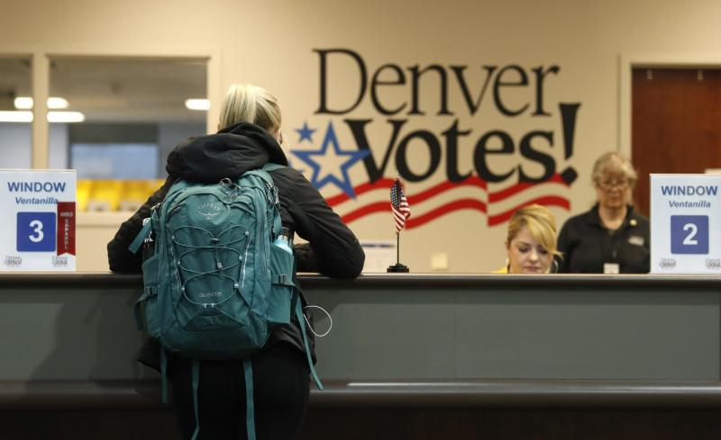 """A voter fills out her ballot at the Denver Elections Division Tuesday, May 7, 2019, in Denver. Voters could make Denver the first U.S. city to decriminalize the use of psilocybin, the psychoactive substance in """"magic mushrooms"""" if the measure passes. (AP Photo/David Zalubowski)"""