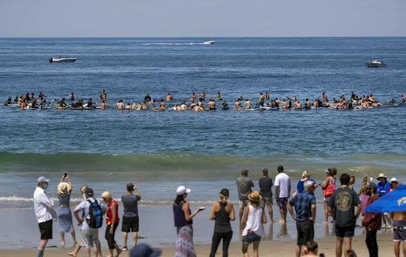 Family and friends of former USC lineman Max Tuerk celebrated his life on Saturday morning at Salt Creek Beach in Dana Point, paddling out. He died at age 26 on June 20 while hiking.