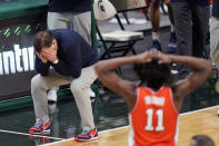 Illinois head coach Brad Underwood and guard Ayo Dosunmu (11) react after a play during the second half of an NCAA college basketball game against Michigan State, Tuesday, Feb. 23, 2021, in East Lansing, Mich. (AP Photo/Carlos Osorio)