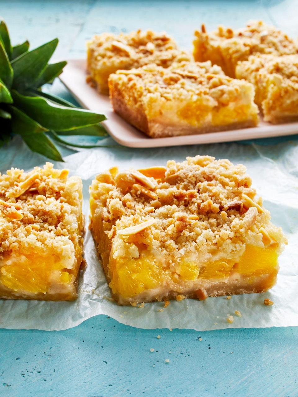 "<p><strong>Recipe: </strong><a href=""https://www.southernliving.com/recipes/buttery-pineapple-crumble-bars"" rel=""nofollow noopener"" target=""_blank"" data-ylk=""slk:Buttery Pineapple Crumble Bars"" class=""link rapid-noclick-resp""><strong>Buttery Pineapple Crumble Bars</strong></a></p> <p>Our readers who love to bake had so much fun with these sweet bars that use sweet pineapple and kitchen staples like flour, butter, and sugar. Bake a batch to make your neighbor's day! Readers even adapted this recipe with peaches, blueberries, and mangoes.</p>"