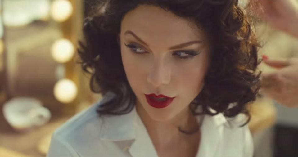 """<p>Known for her blonde hair, Swift <a href=""""https://www.yahoo.com/beauty/taylor-swift-goes-brunette-in-wildest-dreams-127989577473.html"""" data-ylk=""""slk:went brunette for her """"Wildest Dreams"""" music video;outcm:mb_qualified_link;_E:mb_qualified_link;ct:story;"""" class=""""link rapid-noclick-resp yahoo-link"""">went brunette for her """"Wildest Dreams"""" music video</a>, which debuted at the VMAs. Her retro curls and red lips were very old Hollywood glam. </p><p>Source: Getty Images<br></p>"""