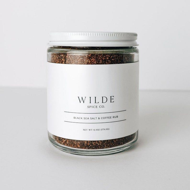 """<p><strong>WildeSpiceCo</strong></p><p>etsy.com</p><p><strong>$13.99</strong></p><p><a href=""""https://go.redirectingat.com?id=74968X1596630&url=https%3A%2F%2Fwww.etsy.com%2Flisting%2F744888822%2Fblack-sea-salt-coffee-rub&sref=https%3A%2F%2Fwww.thepioneerwoman.com%2Fholidays-celebrations%2Fgifts%2Fg32268043%2Fgifts-for-husbands%2F"""" rel=""""nofollow noopener"""" target=""""_blank"""" data-ylk=""""slk:Shop Now"""" class=""""link rapid-noclick-resp"""">Shop Now</a></p><p>Does he love grilling <em>and</em> coffee? Then he'll get a kick out of this delicious rub.</p>"""