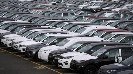 FILE PHOTO: New Land Rover cars are seen in a parking lot at the Jaguar Land Rover plant at Halewood in Liverpool, northern England, September 12 , 2016. REUTERS/Phil Noble/File Photo
