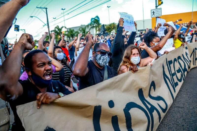 People protest against the death of a black man in front of supermarket Carrefour, where his beating took place, in Porto Alegre, Rio Grande do Sul, Brazil, on November 20, 2020, on Black Consciousness Day.