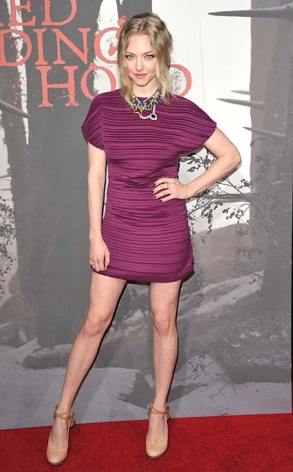 """Amanda Seyfried showed off her stems upon arriving at the Los Angeles premiere of her new thriller, """"Red Riding Hood,"""" in a perfectly pleated Lanvin mini and strappy leather platform pumps. A layered Tom Binns necklace and loose updo completed her lovely look. John Shearer/<a href=""""http://www.wireimage.com"""" target=""""new"""">WireImage.com</a> - March 7, 2011"""