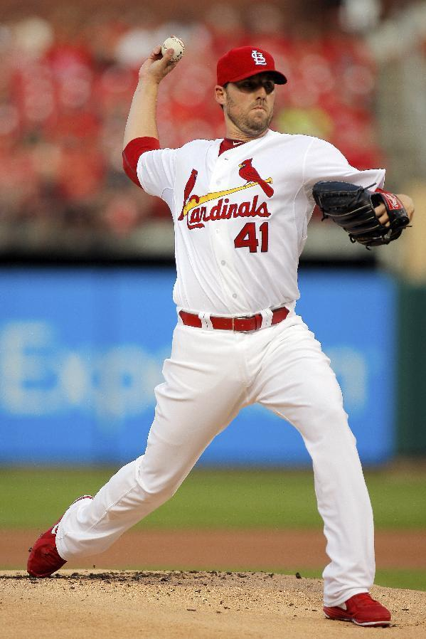 St. Louis Cardinals starting pitcher John Lackey throws during the first inning of a baseball game against the Cincinnati Reds, Tuesday, Aug. 19, 2014, in St. Louis. (AP Photo/Scott Kane)