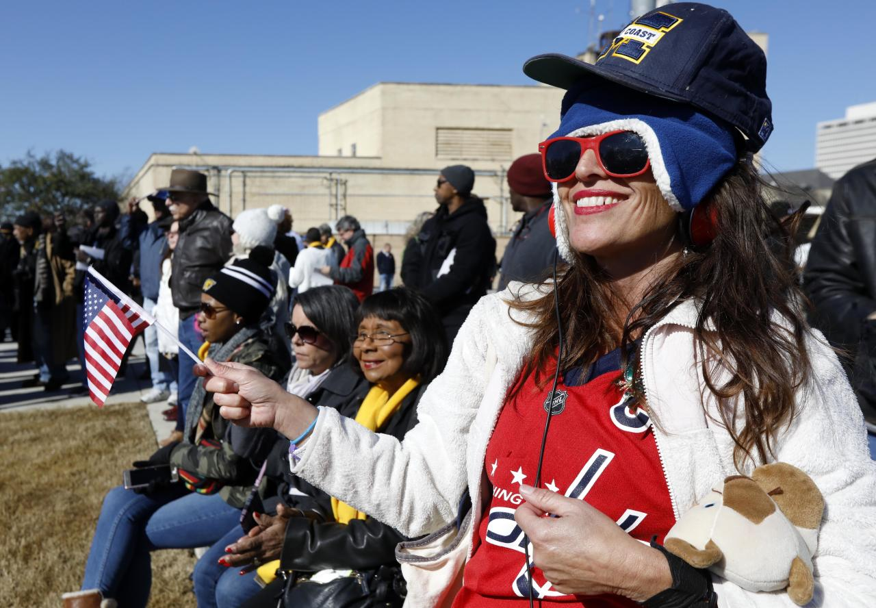 <p>Michael Avandale, of Los Angeles, waves an American flag as she and others enjoy the state's bicentennial celebration and the grand opening ceremony for the two museums, the Museum of Mississippi History and the Mississippi Civil Rights Museum, Saturday, Dec. 9, 2017, in Jackson, Miss. (Photo: Rogelio V. Solis/AP) </p>