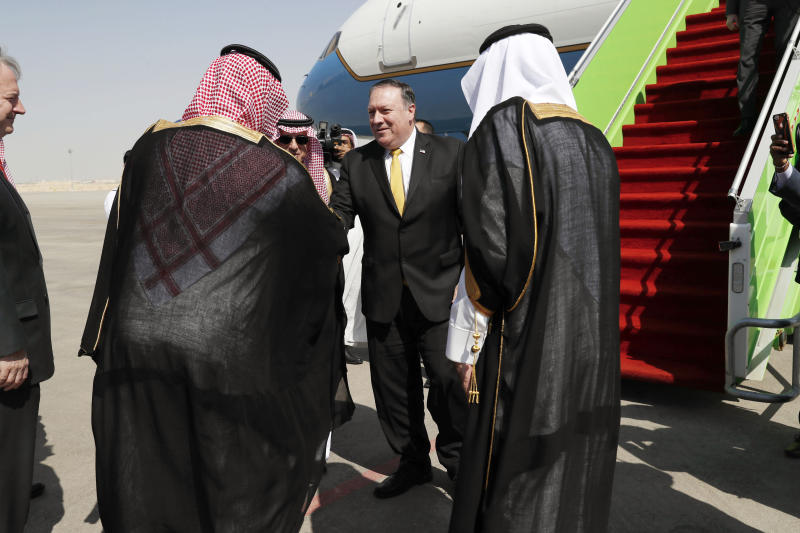 U.S. Secretary of State Mike Pompeo, centre, is greeted by Saudi Foreign Minister Adel al-Jubeir, left, after arriving in Riyadh, Saudi Arabia, Tuesday Oct. 16, 2018. Pompeo arrived Tuesday in Saudi Arabia for talks with King Salman over the unexplained disappearance and alleged slaying of Saudi writer Jamal Khashoggi, who vanished two weeks ago during a visit to the Saudi Consulate in Istanbul.(Leah Millis/Pool via AP)