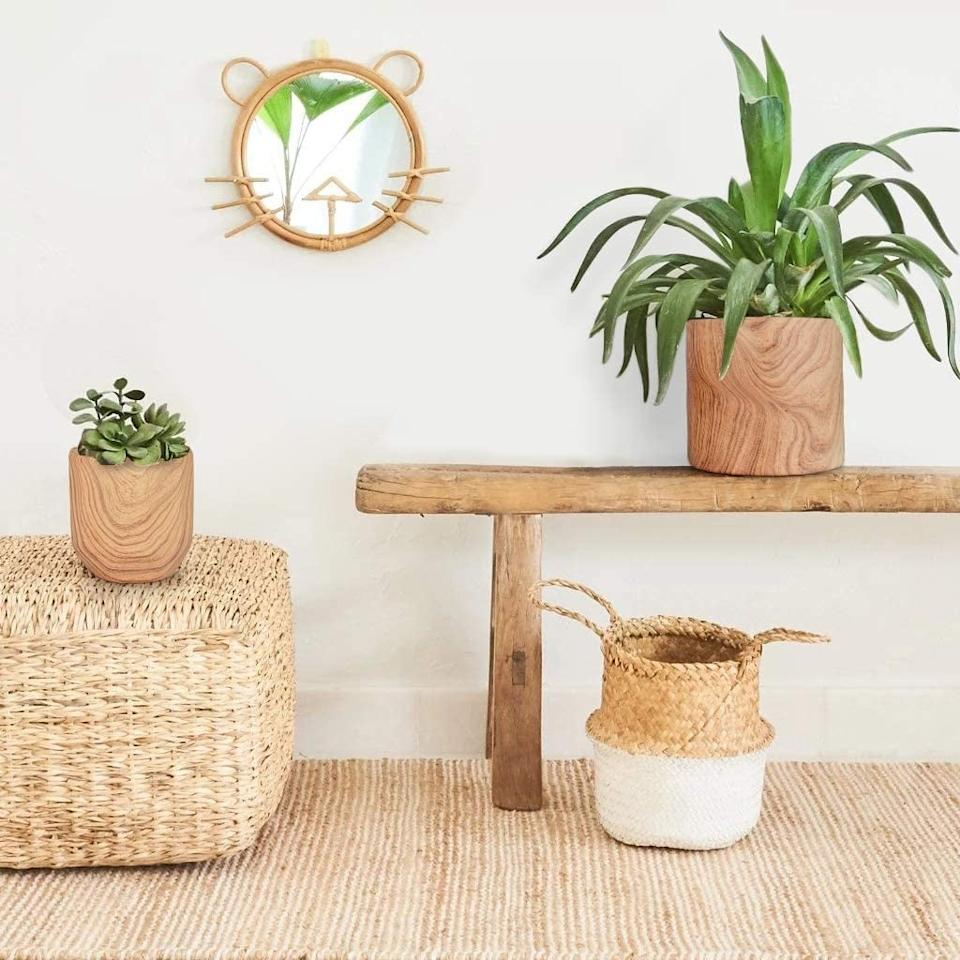 "<p>We're into the wood finish on these <a href=""https://www.popsugar.com/buy/Homenote-Plant-Pots-581168?p_name=Homenote%20Plant%20Pots&retailer=amazon.com&pid=581168&price=30&evar1=casa%3Aus&evar9=45784601&evar98=https%3A%2F%2Fwww.popsugar.com%2Fhome%2Fphoto-gallery%2F45784601%2Fimage%2F47575654%2FHomenote-Plant-Pots&list1=shopping%2Cproducts%20under%20%2450%2Cdecor%20inspiration%2Caffordable%20shopping%2Chome%20shopping&prop13=api&pdata=1"" rel=""nofollow"" data-shoppable-link=""1"" target=""_blank"" class=""ga-track"" data-ga-category=""Related"" data-ga-label=""https://www.amazon.com/HOMENOTE-Ceramic-Planter-Natural-Texture/dp/B07W7BVHMW/ref=sr_1_31?dchild=1&amp;keywords=plant+pots&amp;qid=1591835127&amp;sr=8-31"" data-ga-action=""In-Line Links"">Homenote Plant Pots</a> ($30, originally $33).</p>"