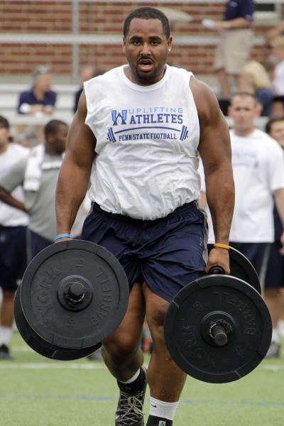 Penn State defensive tackle Jordan Hill participates in a relay against the offense during the 10th annual Uplifting Athletes Lift for Life at Penn State University in State College, Pa., Friday, July 13, 2012. Penn State tailback Silas Redd still stands by his former coach Joe Paterno. Defensive tackle Hill does, too. (AP Photo/Gene J. Puskar)