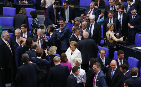 German Chancellor Angela Merkel reacts after being re-elected as chancellor during a session of the German lower house of parliament Bundestag in Berlin, Germany, March 14, 2018. REUTERS/Hannibal Hanschke