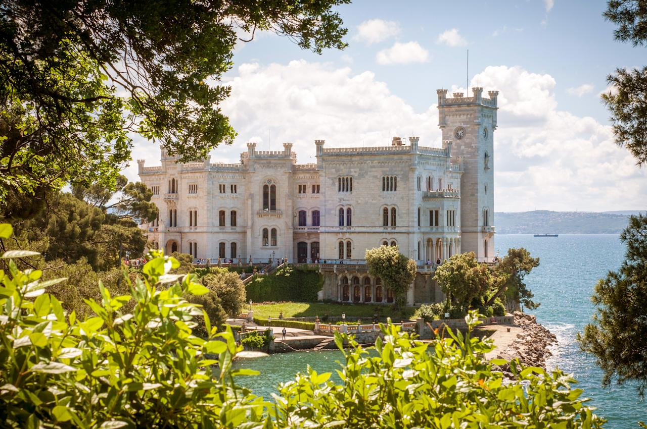 """Just a 30-minute drive north of Trieste—the photogenic heart of <a href=""""https://www.cntraveler.com/story/friuli-venezia-giulia-is-an-italy-far-removed-from-its-stereotypes?mbid=synd_yahoo_rss"""">Friuli Venezia-Giulia</a>—Castello di Miramare has one of the most scenic locations of all the castles on this list. Formerly home to Austrian Archduke Ferdinand Maximilian, the 10th-century structure sits above the blue Adriatic on a lush, 54-acre park. It's certainly not your average <a href=""""https://www.cntraveler.com/story/italy-road-trip-friuli-to-trentino?mbid=synd_yahoo_rss"""" target=""""_blank"""">road trip</a> pit stop."""