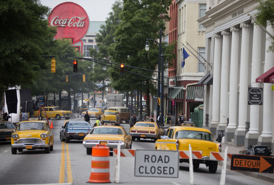 "<p> Downtown Peachtree Street serves as a vintage New York City street scene for the movie ""Anchorman: The Legend Continues,"" Friday, May 10, 2013, during filming in Atlanta. The film, a sequel to 2004's ""Anchorman: The Legend of Ron Burgundy,"" is scheduled for release nationwide on Dec. 20, 2013. (AP Photo/David Goldman)</p>"