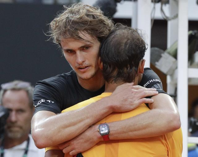 Spain's Rafael Nadal hugs Germany's Alexander Zverev, face to camera, at the end of their final match at the Italian Open tennis tournament, in Rome, Sunday, May 20, 2018. Nadal won 6-1, 1-6, 6-3. (AP Photo/Gregorio Borgia)