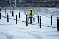 A woman walks through snow outside in Hexham, Northumberland. Heavy snow and freezing rain is set to batter the UK this week, with warnings issued over potential power cuts and travel delays. (Photo by Owen Humphreys/PA Images via Getty Images)